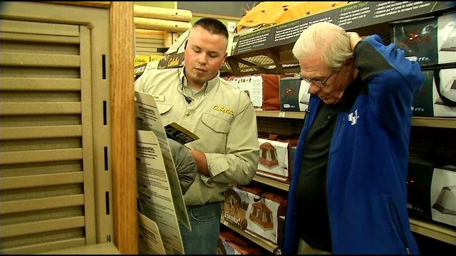 Bardstown resident and pastor Larry Meade shops for supplies to take to Nepal at Cabela's. He said people there needs tarps and tents.