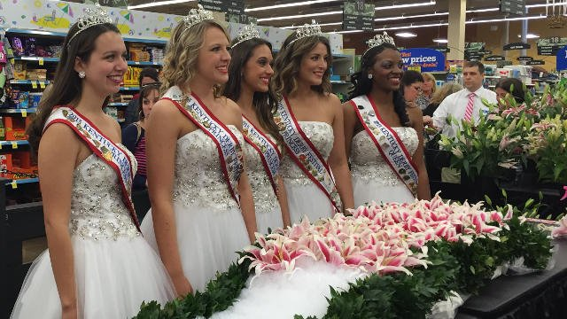 Derby princesses pose with the Garland of Lilies as workers at Kroger put the finishing touches on.