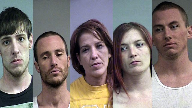 Five people have been arrested after Shively Police say they were found in a home with drugs, guns and cash.
