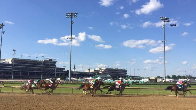 The Kentucky Oaks field passes into the second turn Friday May 2, 2015.