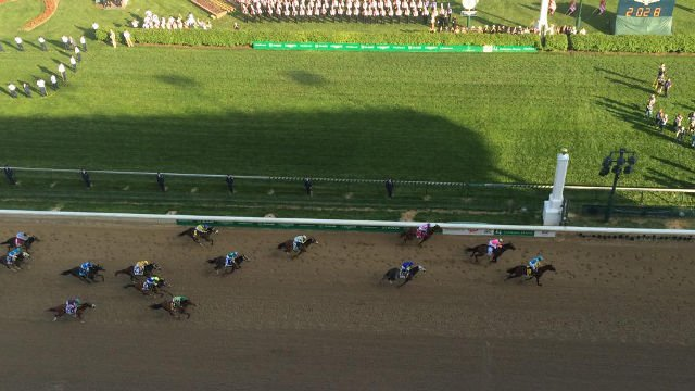 American Pharoah crosses the finish line first at the 141st Kentucky Derby on May 2, 2015.