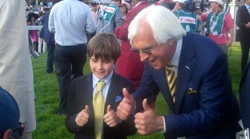 Bob Baffert celebrates American Pharoah's Kentucky Derby victory with his son, Bode.