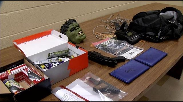 After the teen's arrest, the Clark County Sheriff's Office says they recovered a bag of cash, a mask, guns and deposit bags with a store name on it.