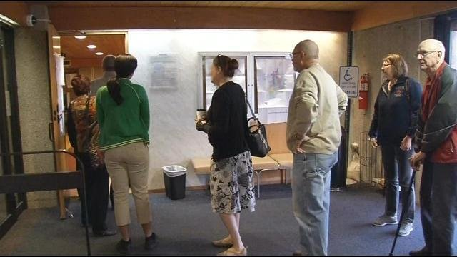 People wait inside the New Albany-Floyd County library to cast their vote in the primary.