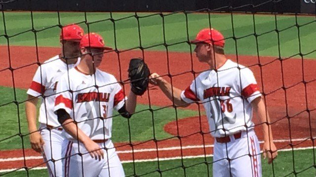 Freshman pitcher Brendan McKay is greeted by Louisville teammates after six scoreless innings.