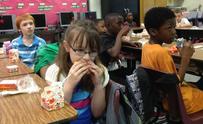 Cochran Elementary School students eat breakfast in their classroom on Tuesday morning.