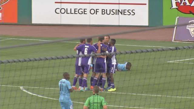 Louisville City players crowd around Magnus Rasmussen after he scored the team's first of three goals against the Wilmington Hammerheads May 12, 2015.