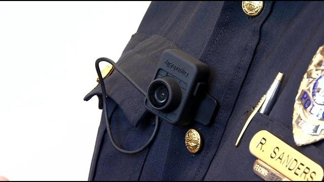 Chief Rick Sanders shows the body cameras Jeffersontown Police will begin wearing soon.