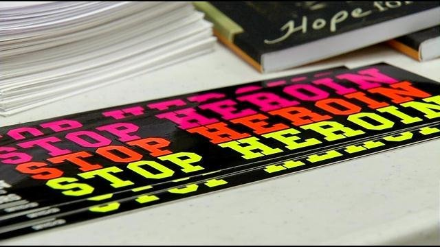 In this file photo, pamphlets, books and bumper stickers were laid out at an event Wednesday night, May 13, 2015, to help people understand heroin addictions (FILE).