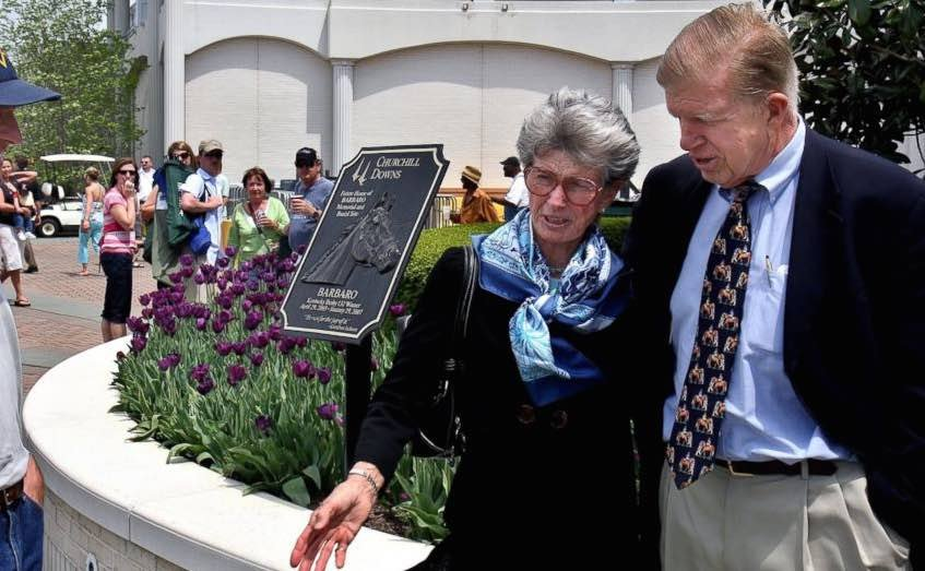 In this 2008 file photo, Roy and Gretchen Jackson visit the Barbaro statue outside Churchill Downs. (AP photo)