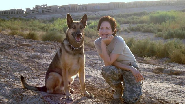 Jessica Montgomery pictured with a dog she worked with in Iraq. (Courtesy: Jessica Montgomery)
