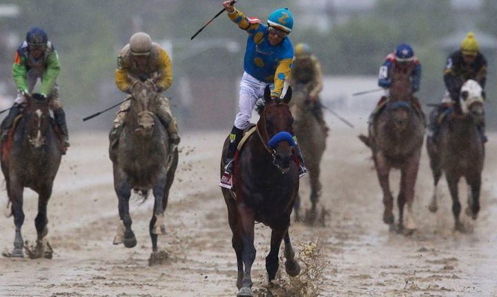 American Pharoah had no trouble with the slop or competition in winning the Preakness Stakes. AP photo.