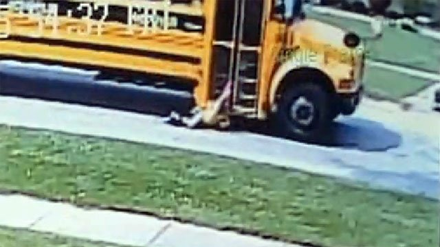 Nearby surveillance cameras caught the moments as a seven-year-old was dragged by a JCPS bus when her backpack got caught in the door.