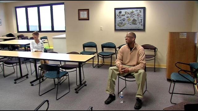 Deshaun Grant, an employee of Kosair Children's Hospital, waits to meet a patient who has wanted to thank him for six years for helping her recover.