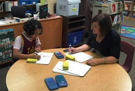 WDRB education reporter works with a Middletown Elementary School fourth grader during one of her school visits.