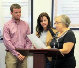 Kellie Davis, center, a librarian at Bullitt East High School, is accused of mishandling funds.
