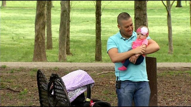 Detective Joshua Jaynes holds his daughter.
