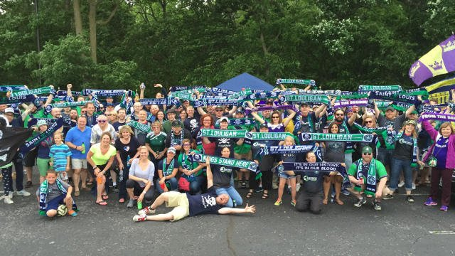 The Saint Louligans and Louisville fans who made the trip pose for a picture at their joint tailgate Sunday May 24, 2015.