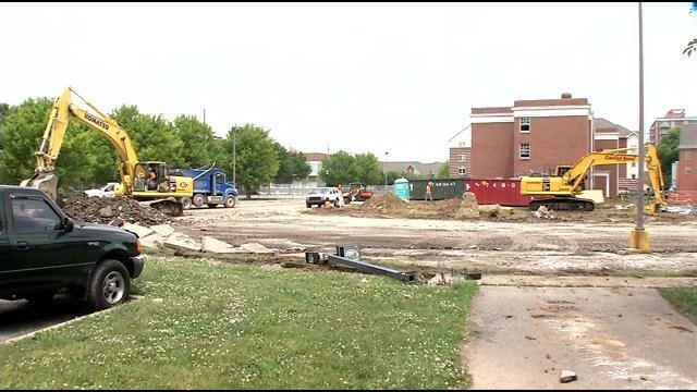 Demolition is underway on the campus to tear down three old dorms to make way for a new one.