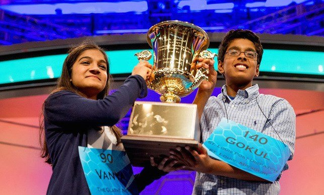 Vanya Shivashankar, left, 13, of Olathe, Kan., and Gokul Venkatachalam, 14, of St. Louis, hold up the championship trophy as co-champions after winning the finals of the Scripps National Spelling Bee, Thursday, May 28, 2015, in Oxon Hill, Md. (AP Photo)