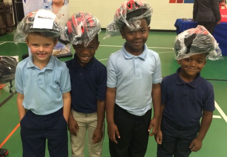 Portland Elementary students sport their new bike helmets (Photo by Toni Konz, WDRB News)