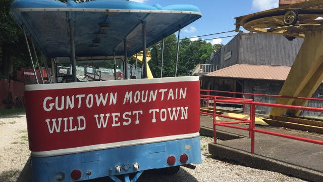 A tram takes guests up to Guntown USA at the top, which has everything from a saloon, an outdoor amphitheater and even the old jail.