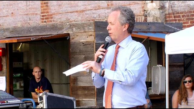 Mayor Greg Fischer announces Louisville's official cocktail at Resurfaced on Thursday.