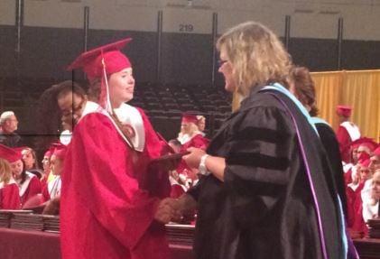 Macy Knights gets her diploma from Ballard High School principal Staci Eddleman on Friday night (Photo by Toni Konz, WDRB News)