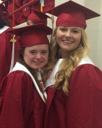 Macy Knights poses for a picture on graduation night with a friend, Caroline Koenig (Photo by Toni Konz, WDRB News)