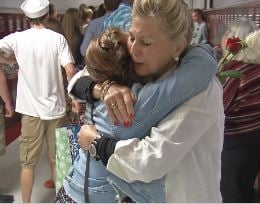 Macy Knights is hugged by a teacher during the senior walk at Ballard High School on Tuesday, June 2, 2015 (Photo by Toni Konz, WDRB News)