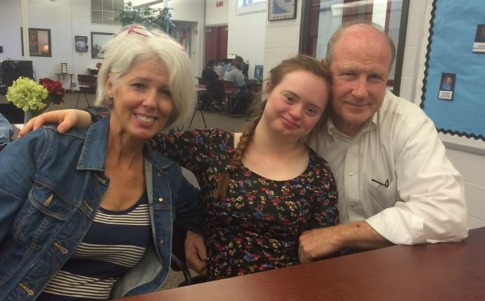 Ballard High graduate Macy Knghts with her parents, Frank and Jennifer Knights (Photo by Toni Konz, WDRB News)