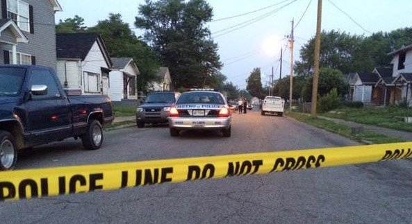 Detectives looked for clues after a man's burning body was found in the 2400 block of Elliott Avenue on June 7.