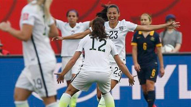 AP Photo United States' Christen Press (23) celebrates her goal against Australia with Lauren Holiday (12) during a FIFA Women's World Cup soccer match in Winnipeg, Manitoba, Monday, June 8, 2015. (John Woods/The Canadian Press via AP)
