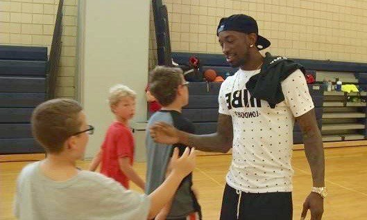 Russ Smith greets campers at his Camp of Champions with Peyton Siva at Collegiate School. (WDRB photo).