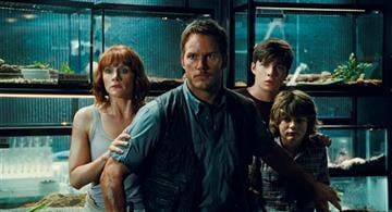 (Universal Pictures/Amblin Entertainment via AP). This photo provided by Universal Pictures shows, Bryce Dallas Howard, from left, as Claire, Chris Pratt as Owen, Nick Robinson as Zach, and Ty Simpkins as Gray.