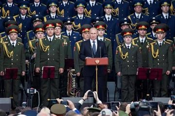 (AP Photo/Ivan Sekretarev). Russian President Vladimir Putin, center, delivers his speech at the opening of the Army-2015 international military show featuring the latest Russian weapons in Kubinka, outside Moscow, Russia, Tuesday, June 16, 2015.