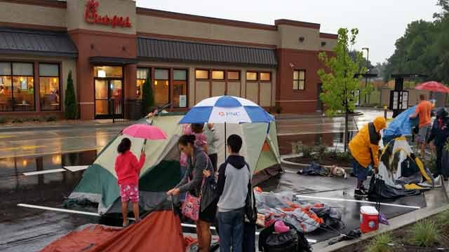 People started lining up early outside Louisville's newest Chick-fil-A with hopes of winning a year's supply of free chicken.