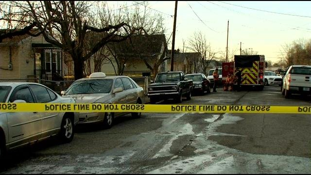 Police and firefighters investigating outside Earl Moore's home in February.