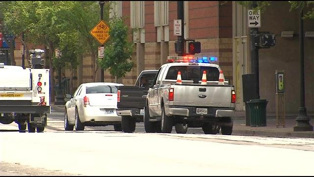 Police are targeting some of the most dangerous intersections in downtown Louisville and watching for illegal and dangerous driving habits. In this photo from Jun. 18, a police truck pulls over someone who ran a red light.