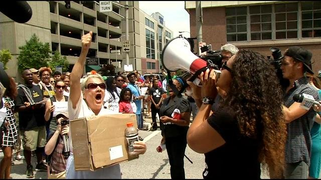 Activists blocked traffic during a rally in downtown Louisville on June 22, 2015. The rally was in response to an open letter from FOP President Dave Mutchler.