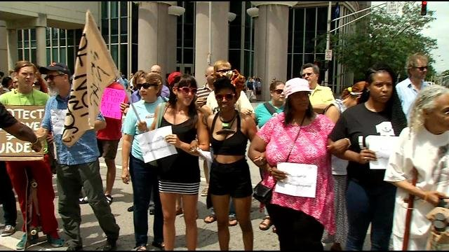 Protesters blocked traffic in downtown Louisville for about 20 minutes on June 22, 2015.
