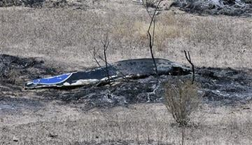 (Mike Eliason/Santa Barbara County Fire Department via AP). Scattered debris remains on the ground following a plane crash near the town of Ventucopa, Calif., Monday, June 22, 2015.