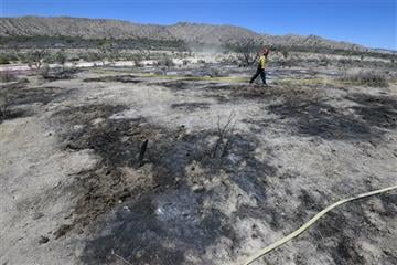 (Mike Eliason/Santa Barbara County Fire Department via AP). A firefighter walks near charred debris following a plane crash near the town of Ventucopa, Calif., Monday, June 22, 2015.
