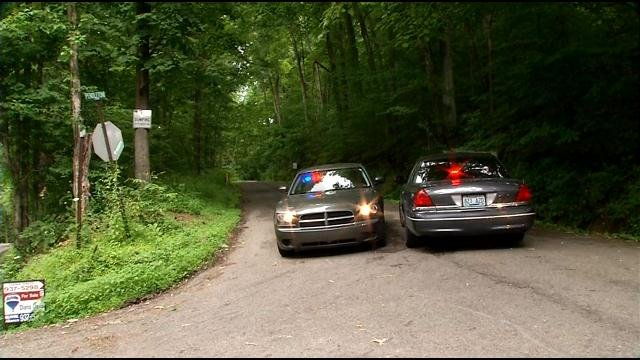 Investigators search for evidence after a woman's body was found near the Jefferson-Bullitt County line.