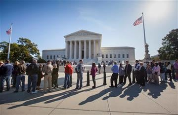 (AP Photo/J. Scott Applewhite, File ). FILE - In this Oct. 16, 2014, file photo, people wait to enter the Supreme Court in Washington.