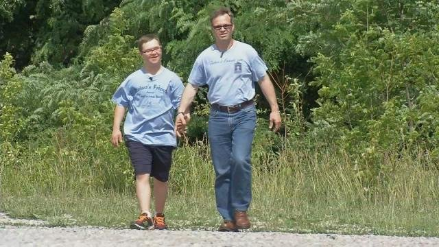 Joshua (left) and his father TJ (right) have been training for this one by walking five miles every evening.