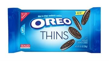 """(Mondelez via AP). This product image provided by Mondelez shows the packaging design for """"Oreo Thins."""" Mondelez International Inc. says it will add """"Oreo Thins,"""" which have a similar cookie-to-filling ratio as regular Oreos, except that they're slimmer."""
