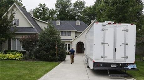 Federal authorities walk into the home of Subway restaurant spokesman Jared Fogle, Tuesday, July 7, 2015, in Zionsville, Ind. (AP Photo/Michael Conroy)