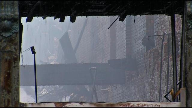Firefighters remained on scene Tuesday, battling hot spots and bracing for more collapses.