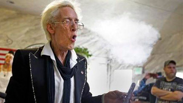 """First Church of Cannabis Founder Bill Levin exhales as he smokes a """"sacrament substitute"""" during the church's first service, Wednesday, July 1, 2015, in Indianapolis (AP Photo/Michael Conroy)."""